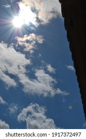 Blue sky with clouds and slihouette of roof's diagonal section