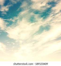 Blue sky, clouds and sun light background. Vintage retro style