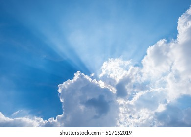 Blue sky with clouds and sun light.
