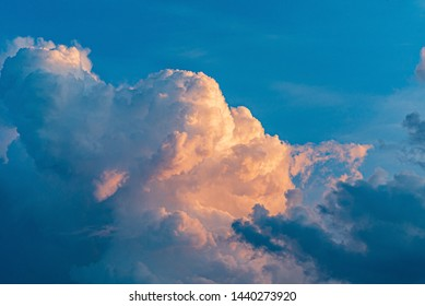 Blue sky with clouds and sun, sunset