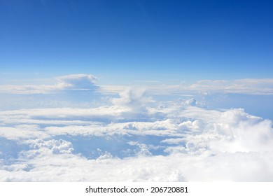 Blue sky and clouds. Top view of aircraft
