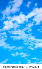 Blue sky with clouds - vertical background,  space for text