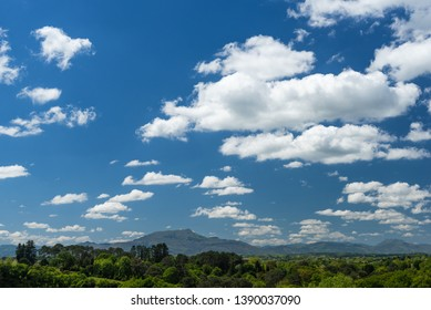 Blue sky colored with white clouds with the Rhune mountain in Arcangues. Basque country of France.