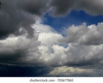 blue sky dark and white clouds as background