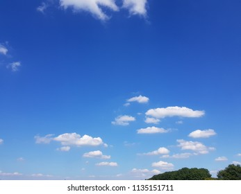 blue blue sky and dotted clouds