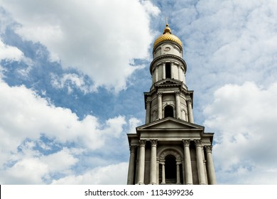 Blue sky with dramatic cloud. Yellow dome. Uspenskiy Sobor Located in the Kharkov Ukraine April 2018