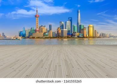 Blue sky, empty marble floor and skyline of Shanghai urban archi