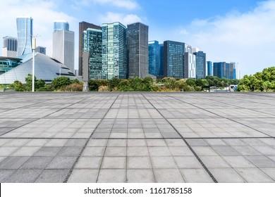 Blue sky, empty marble floor and skyline of Hangzhou urban archi