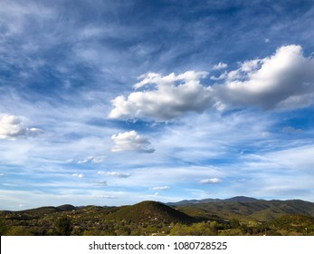 Blue Sky with Fluffy White Clouds Over the Mountains of Santa Fe New Mexico Travel Background Landscape Nature Beautiful Southwest American View