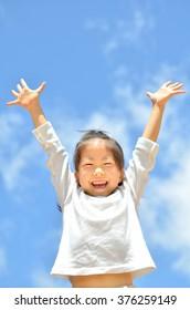 Blue sky girl raise hands