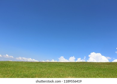 blue sky and green grass nature background