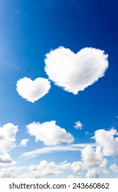 blue sky with hearts shape clouds. Beauty natural background
