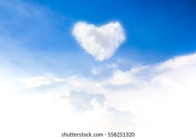 blue sky with hearts shape clouds. Valentine's holiday background