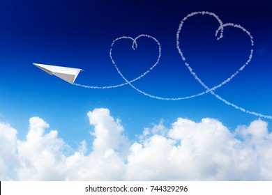 blue sky with hearts shapes and paper plane. Beauty natural background