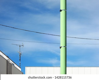 blue sky and housing and transmission line