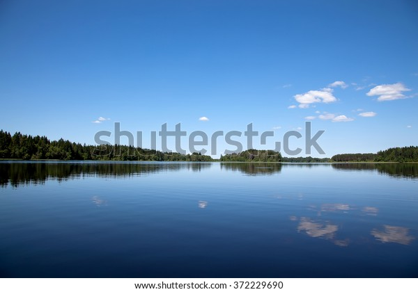 blue-sky-lake-russia-600w-372229690.jpg