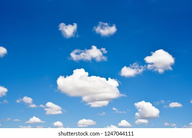 blue sky with lots of white clouds.Many white clouds are independent shapes.