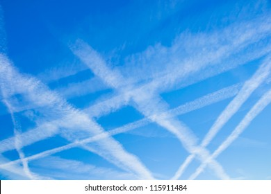 blue sky with many clouds lines made of aircraft