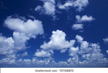 blue sky with many small  fluffy cumulus clouds