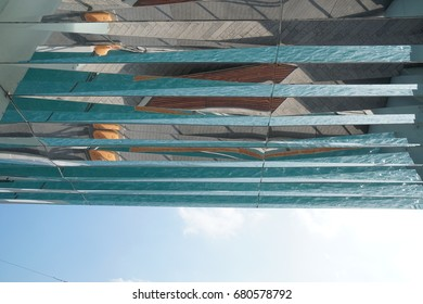 blue Sky with modern geometric reflections in glass ceiling