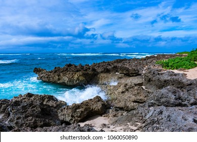 Blue sky, nice ocean and rocks at Alii Beach Park in Haleiwa town at the Northshore of Oahu Island, Hawaii USA