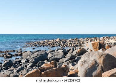 Blue sky, ocean and rock formations - coastline on a sunny winter's day at Bingi, near Moruya in NSW, Australia. Nature background.