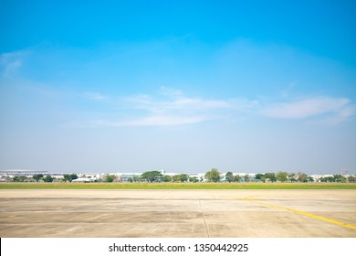 Blue sky and old worn runway. Empty Large Concrete Ground. Copy space.