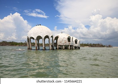 Blue sky over the Cape Romano dome house ruins in the Gulf Coast of Florida