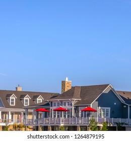 Blue sky over homes in sunny Daybreak Utah