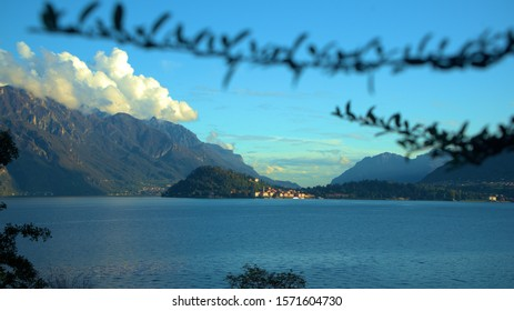a blue sky over the lake in the alps