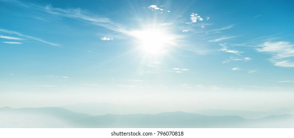 Blue sky panorama with shining sun rays