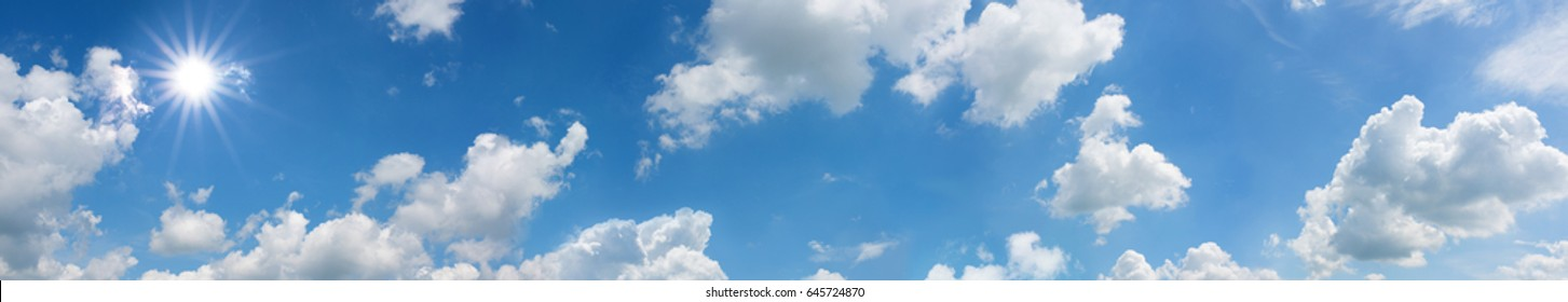 Blue sky panorama with sun and white clouds in summer