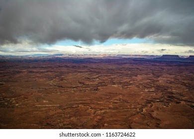 Blue sky is peeking out of the clouds at the Needles Overlook in Canyon Rims Recreational Area, outside Canyonlands NP west of Monticello in Utah. The view of the desert and its canyons is magnificent