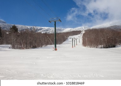 Blue sky perfect snow day at Stowe, Vermont ski mountain