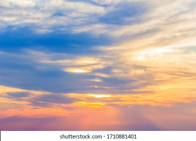 Blue sky with picturesque clouds at sunset in the summer evening