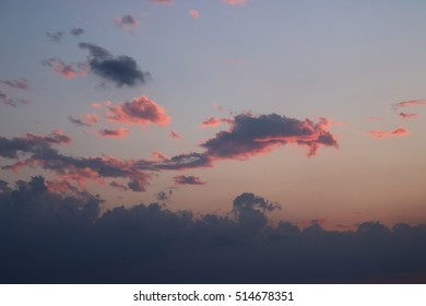 Blue sky with pink and grey coloured clouds from the sunset