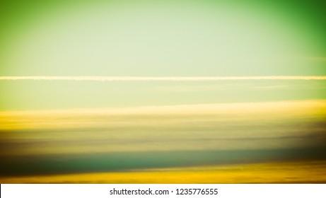 blue sky with plane vapour trails (aka contrails, short for condensation trails) vintage retro