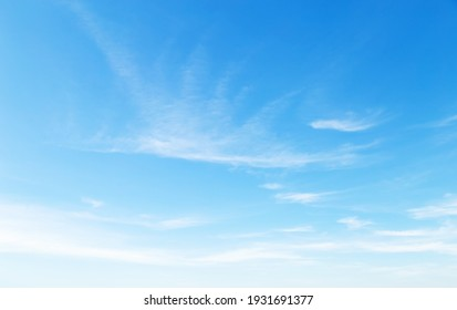 blue sky with puffy clouds background