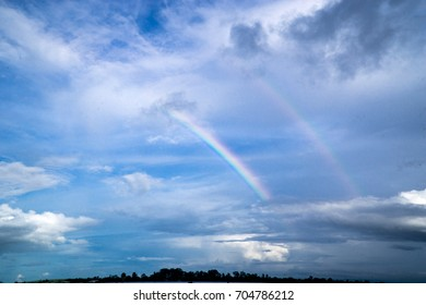 Blue sky and rainbow.