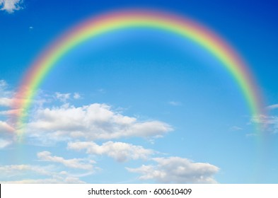 a blue sky rainbow background (clouds) .