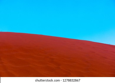 Blue sky and red sand