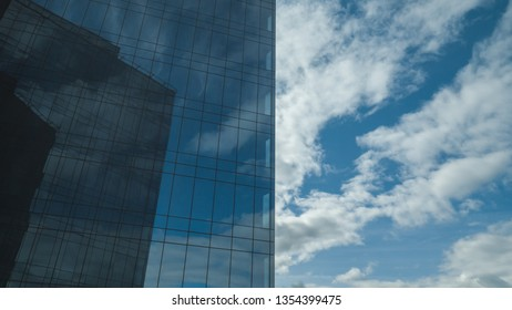 Blue sky, reflected in a sleek wall of a high building