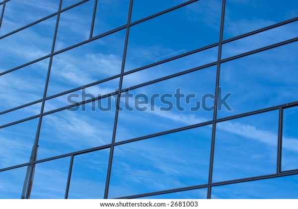 Blue sky reflecting itself in a building