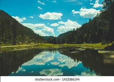 Blue sky reflecting on valley lake