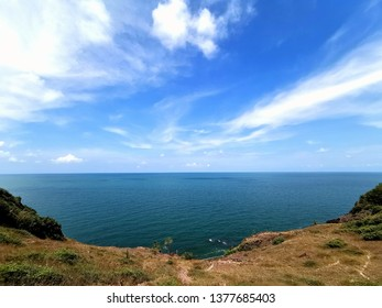 blue sky with sea and land
