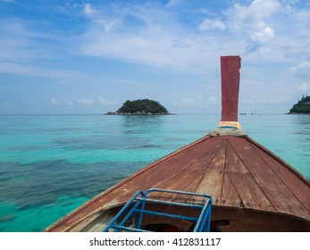 Blue sky and sea  on the boat,,Emerald sea,Traveling long boat,scuba boat,summer at Andaman sea,You can see are corals under sea,Very clear water,Lipe island,Koh Lipe Stul Thailand. - Shutterstock ID 412831117