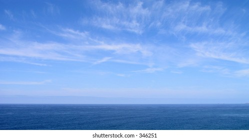 Blue sky and sea with slight cloud