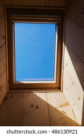 Blue sky seen through a roof window