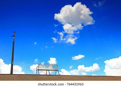 blue sky and silent chair