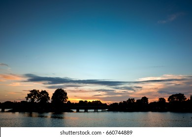 Blue sky, silhouette trees, river and sunset, Landscape thailand